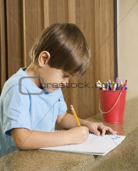 Boy writing.