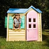 Boy in playhouse.
