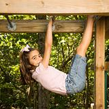 Girl on monkey bars.