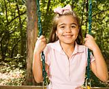 Girl portrait on swing.