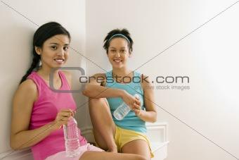 Fitness women taking break