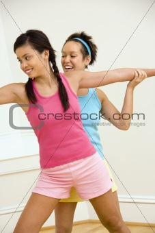 Smiling women doing yoga