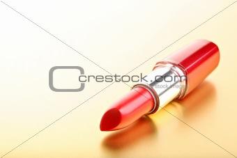 lipstick closeup golden background