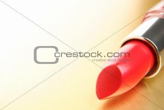 lipstick on gold background