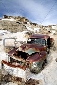abandoned car in snow