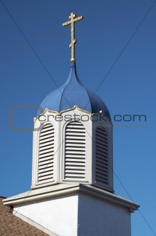 Church steeple against a blue sky