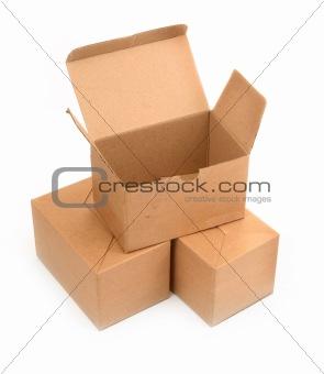 three cardboard boxes on white