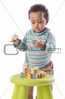 Baby playing with small pieces