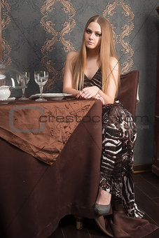 Attractive blond sad girl waiting in cafe