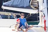 family at sailing boat