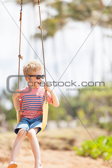boy at swings