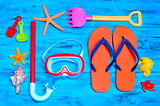summer stuff, such as a pair of flip-fllops, a diving mask or a