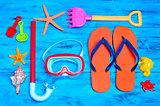 summer stuff, such as a pair of flip-fllops, a diving mask or a
