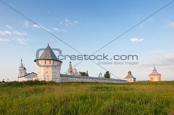 Old monastery and green meadow in summer