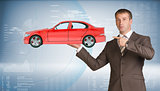 Businessman holding car
