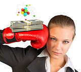 Businesswoman in red boxing gloves