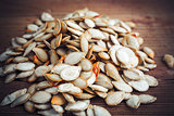 pumpkin seeds on wood background