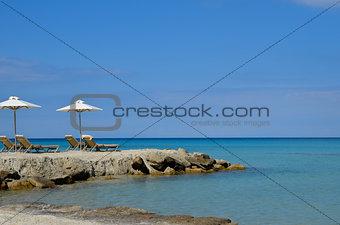 Crystalline Mediterranean Sea on a white sand beach