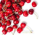 Pours pile of juicy sweet cherries
