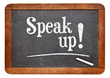Speak up motivational phrase on blackboard