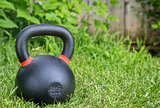 heavy competition  kettlebell on grass