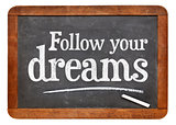 Follow your dreams - text on blackboard