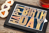 happy birthday on tablet with tea and cookies