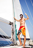 Happy man on sailboat