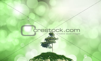 3D tree on a hill against a defocussed background