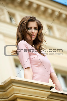 charming girl near antique building