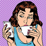 Tuesday girl looks at smartphone drinking tea or coffee