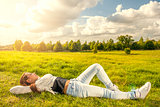 Beautiful teenager lying on the grass