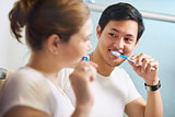 Couple With Toothbrush Man And Woman Washing Teeth Together