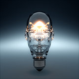 Glass head shaped light bulb glowing