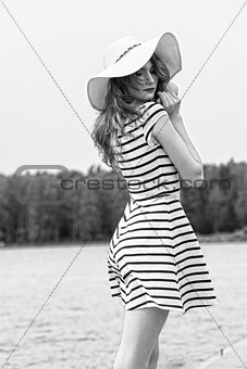 BW shot pretty girl outside in white with hat