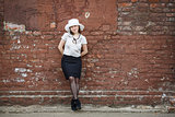 Woman on the brick wall background