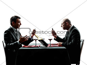 business using smartphones dinner silhouettes