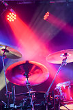 drum kit under spotlights