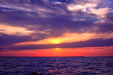 Amazing Sunset over an ocean with clouds