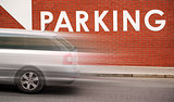 Car Parking Title on Brick Wall