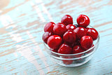 Sweet Cherry in Glass Bowl on Rustic Table