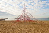 Rope pyramid playground in the beach