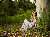 Beautiful young lady in the forest