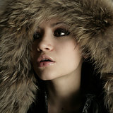 Young pretty woman with fur