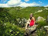 Elegant young lady in the mountains
