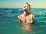 Beautiful elegant woman in the sea