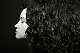 Elegant girl with curly hair