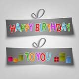 Birthday card with dark labels and gifts