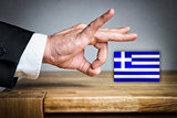 Man shoots Greek Flag off