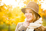 Fashion Woman in Hat on Autumn Background